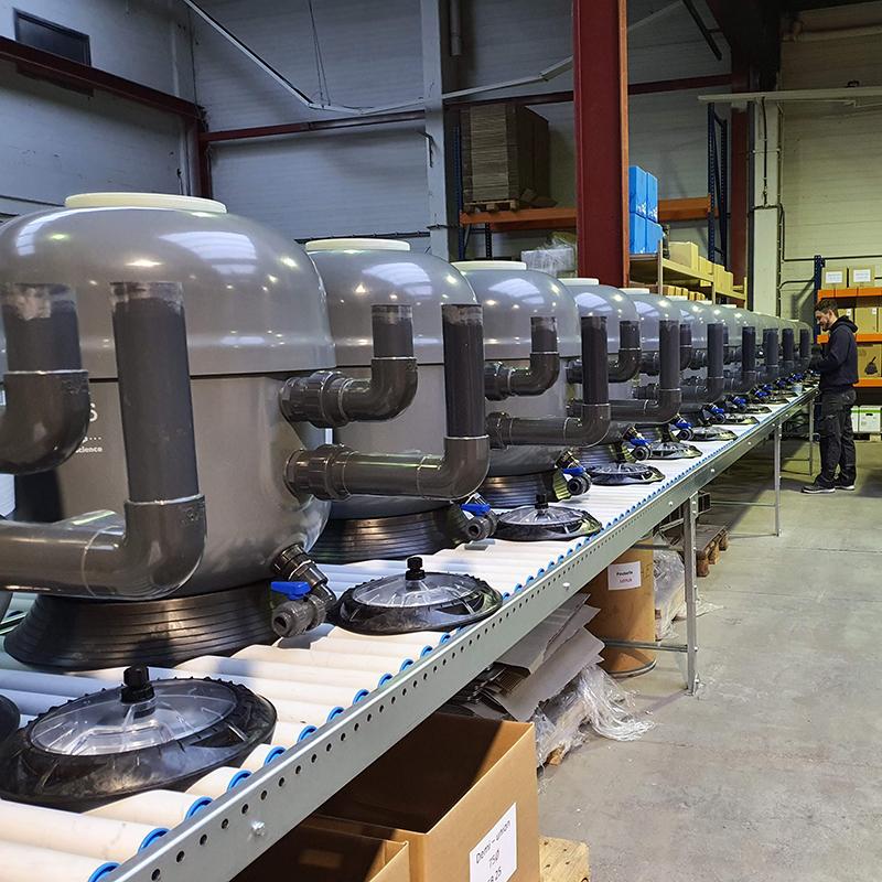 Convoyeur à rouleaux gravitaires en PVC pour l'accumulation de produits finis